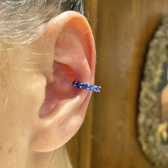 GOLD AND BLUE SAPPHIRE PIERCING