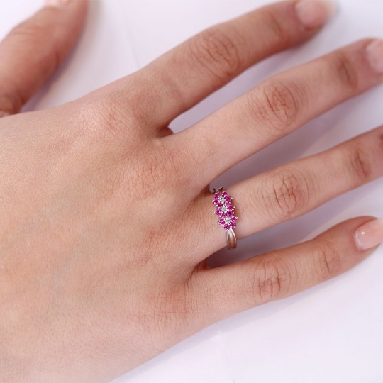 RING WITH THREE ROSETTES OF ROSE SAPPHIRES