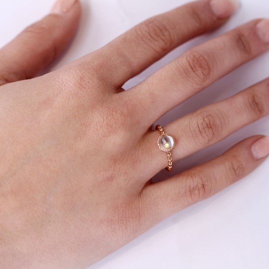 RING OF DIAMONDS WITH WHITE QUARTZ