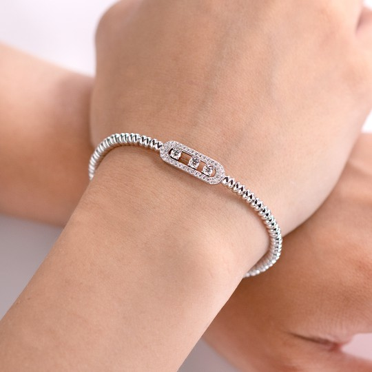 ELASTIC WHITE GOLD BRACELET WITH MOVABLE DIAMONDS